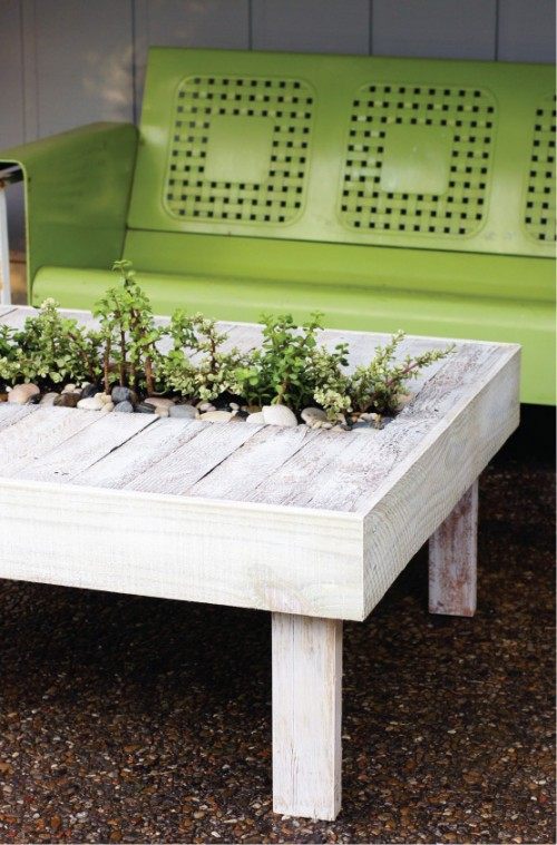DIY wooden patio cocktail table with a planter in the center