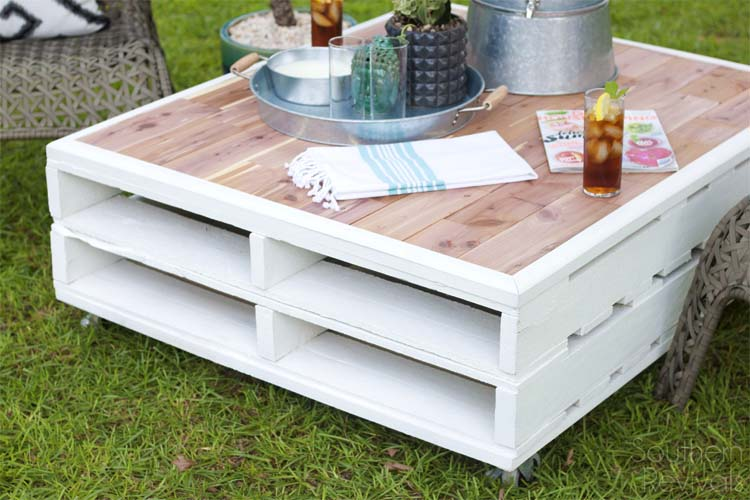 cute DIY pallet coffee table with a pink tabletop (via www.southernrevivals.com)