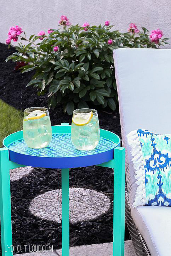DIY stenciled outdoor end table in bright colors (via lydioutloud.com)