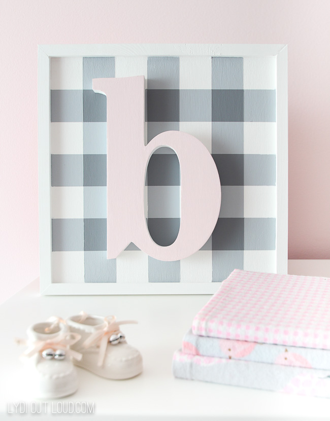 DIY buffalo check nursery sign with a monogram (via lydioutloud.com)
