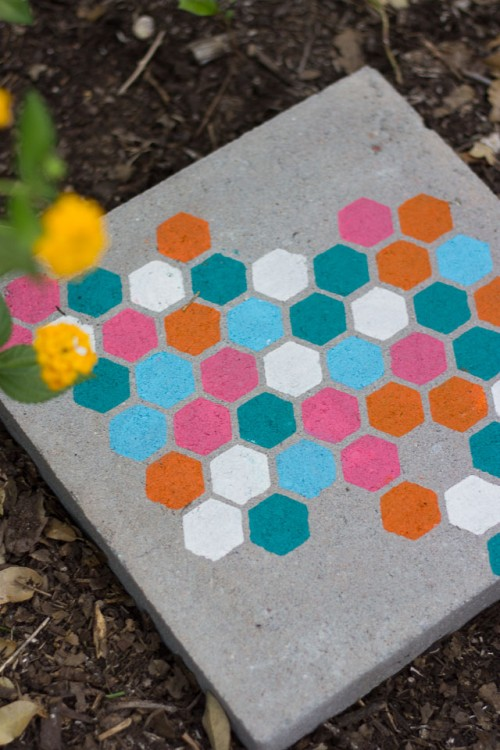 DIY concrete stepping stones with colorful hexagons on top (via www.shelterness.com)