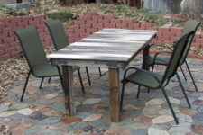 DIY outdoor dining table made of a gate