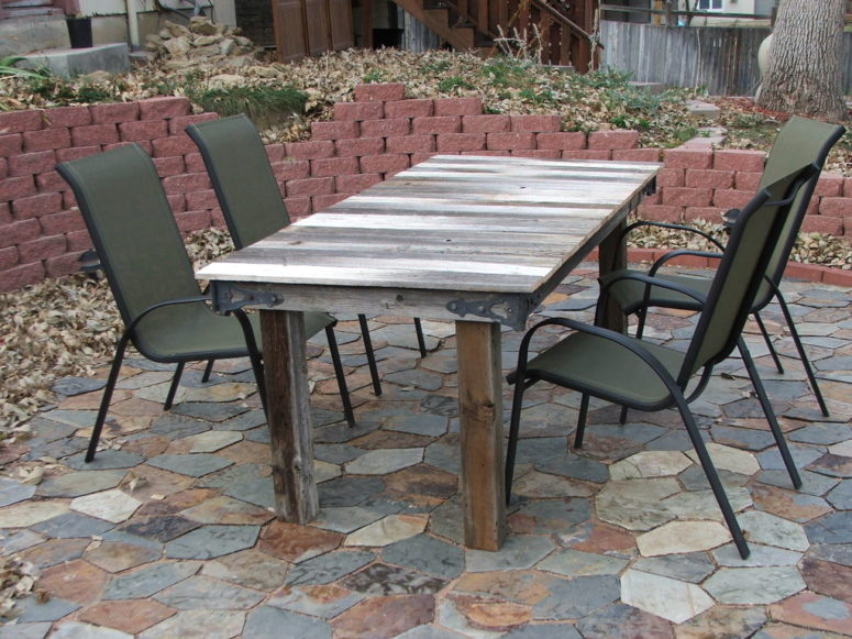 DIY outdoor dining table made of a gate (via www.instructables.com)