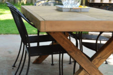 DIY outdoor dining table with a herringbone pattern and X legs