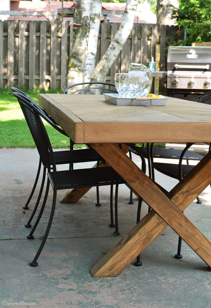 DIY outdoor dining table with a herringbone pattern and X legs (via rogueengineer.com)