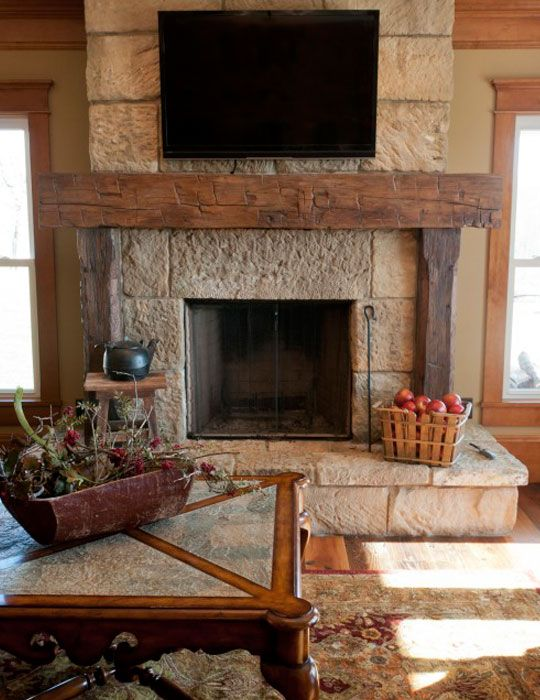a rough stone fireplace with a rough wood mantel for creating a cozy rustic feel in the living room