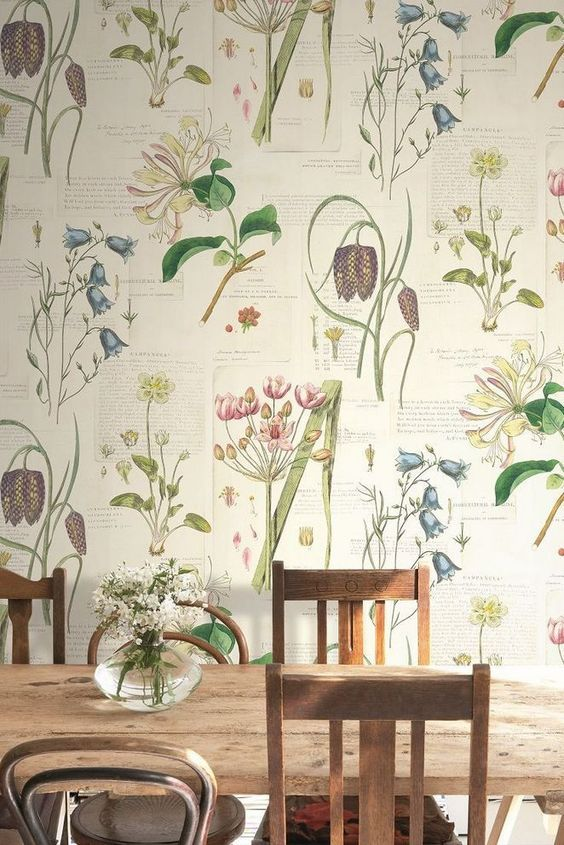vintage botanical print wallpaper is an amazing idea for a dining room, it looks soothing yet catchy