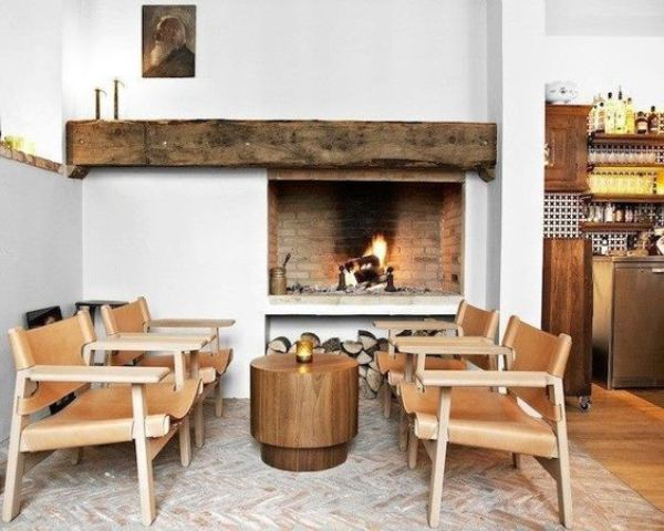 a rough wooden mantel makes the nook less formal and brings a cozy rustic feel to the space