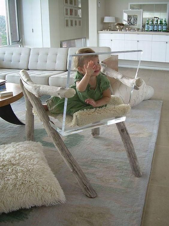 a unique chair made of whitewashed driftwood and acryl is a super modern take on traditional chairs