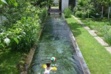 04 a long and narrow pool clad with stone is integrated right into the garden to make it feel lively and very natural