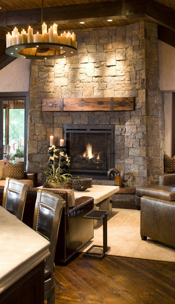 a stone clad fireplace with a rough wood mantel is a chic idea with a rustic feel