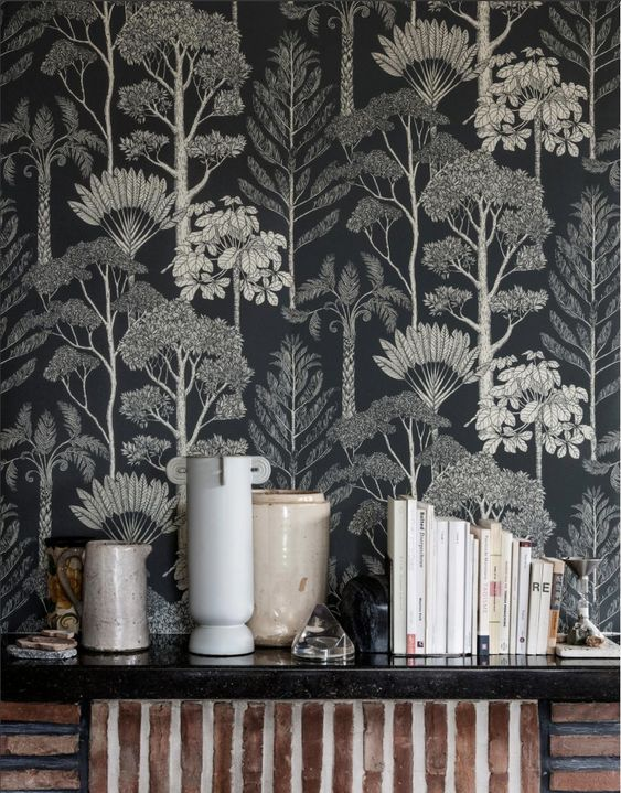 if you prefer moody spaces, choose dark botanical wallpaper to make a statement in your space