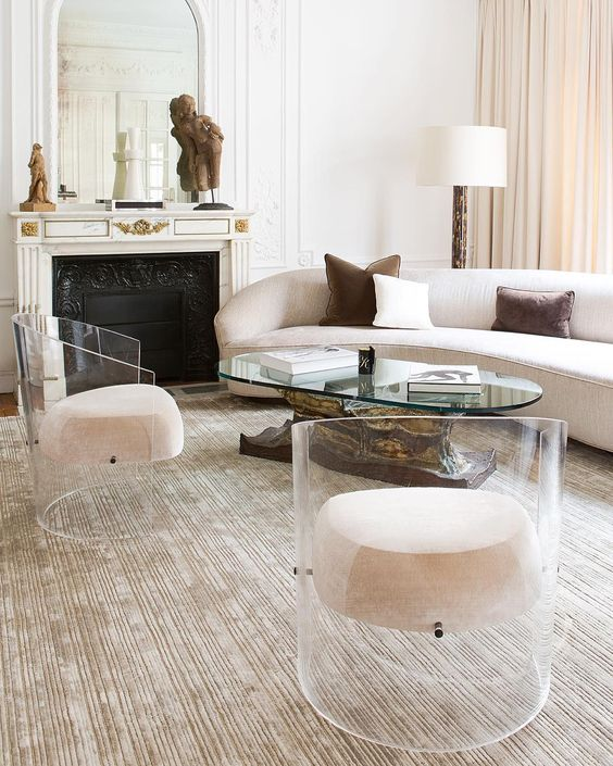 amazing round acrylic chairs with creamy upholstery that seems to be floatign in the mid air