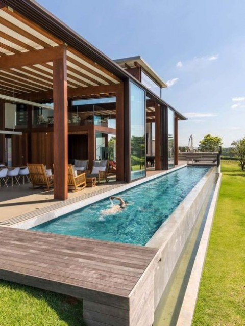 a long narrow pool next to the deck is an ideal solution that won't take much space and will have a great refreshing effect