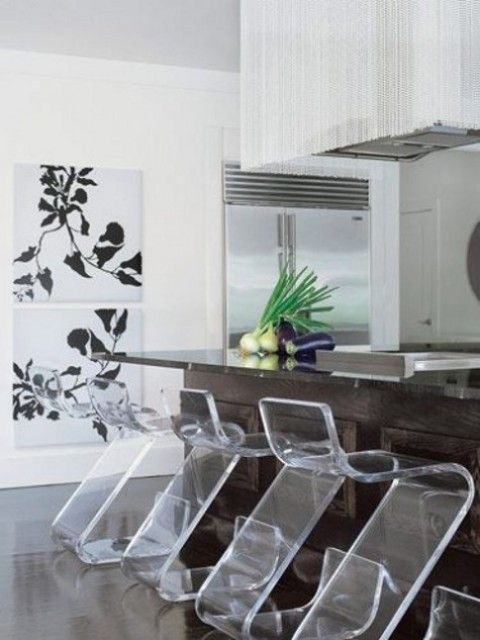 clear acrylic stools contrast the dark stained kitchen island and make the kitchen more contemporary and refreshed