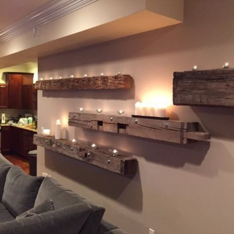 rough wooden beams attached to the wall with lots of candles and lights are amazing to create a mood in your home