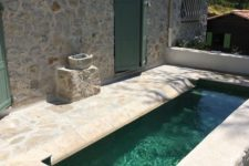 07 a small and rustic backyard done with stone and a narrow and long pool that will refresh you