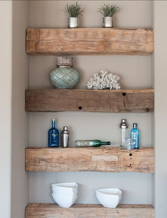 rough wooden slab shelves that occupy an awkward corner and make it functional and practical
