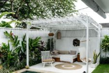 10 a cozy boho chic cabana done in white and neutrals and a small swimming pool clad with neutral tiles