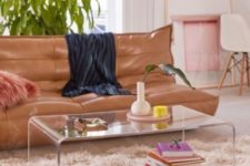 10 a simple curved acrylic coffee table looks ethereal and makes all the items look floating