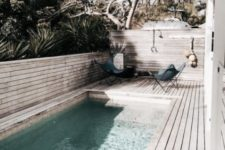 11 a bleached boho wooden deck and a long and narrow pool, which is kept more private with a half wooden wall