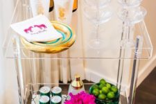 11 an acrylic bar cart is a very modern and glam idea, add gilded decor and you'll get a perfect party-ready cart
