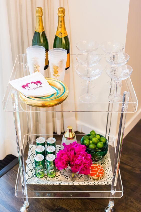 an acrylic bar cart is a very modern and glam idea, add gilded decor and you'll get a perfect party-ready cart