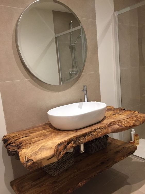 a unique rough wood vanity that contrasts a contemporary vessel sink creating a chic look