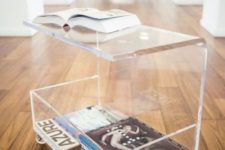 12 an acrylic coffee table on casters with magazine storage and sheer wheels is a very functional option