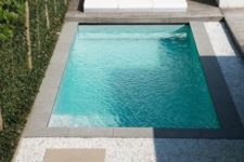 13 a gorgeous minimalist space with a wooden deck, tiled pathways and a small pool clad with grey tiles around