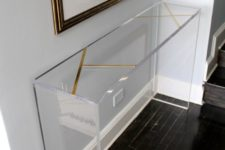 13 an acrylic console table is ideal for an entryway as it looks ethereal and doesn't clutter the space at all