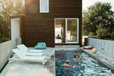 13 white loungers and a turquoise bean bag chair for a long and narrow pool deck