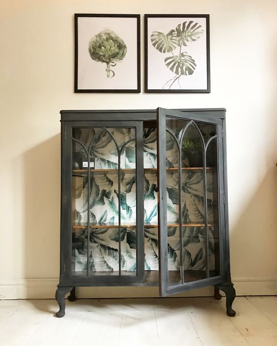 upgrade a vintage glass cabinet with graphite grey paint and botanical leaf print on the back