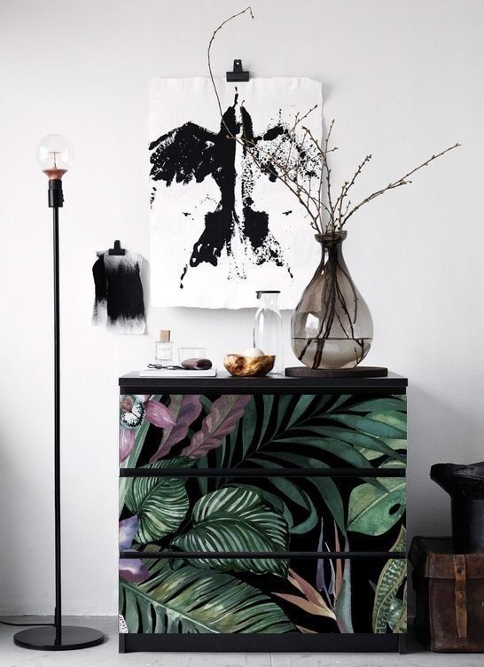 an IKEA makeover - a simple dresser spruced up with moody botanical wallpaper on the drawers