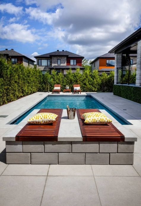 wooden loungers and wooden daybeds with pillows and cushions to relax are a great idea for a minimalist pool deck