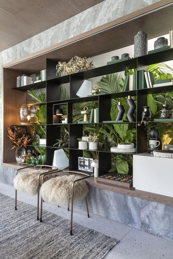 a built-in shelving unit with botanical print wallpaper on the back to make it unique