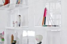 16 clear acrylic box shelves on the wall look very airy and all the items will seem to be floating in mid-air