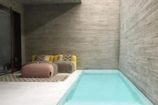 17 a small and minimalist backyard with upholstered furniture and a small and narrow pool with steps