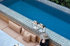 19 a super long and narrow pool fully clad with Moroccan tiles and with a comfortable long sofa to line it up