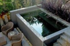 20 a small raised swimming pool with a ladder and a glass door plus a terrace with wicker furniture by its side