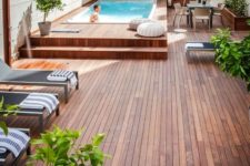 22 a simple contemporary pool deck with loungers, a dining space and soem crochet ottomans looks very lively