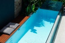 24 a narrow and short pool with a small deck will easily squeeze into your small outdoor space