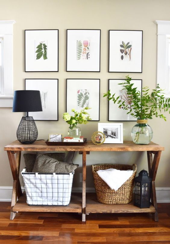 a cozy rustic entryway with a gallery wall of botanicals, which is a creative idea to try