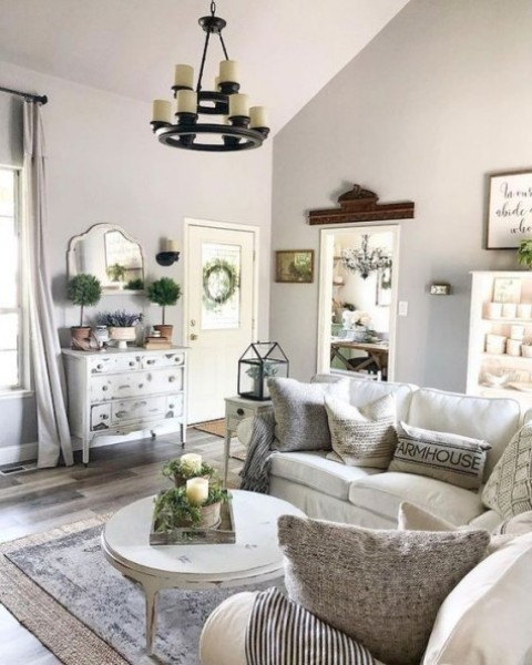 a small farmhouse living room done in neutrals with much texture a vintage chandelier potted greenery and vintage decor - Get Small Farmhouse Living Room Design  Pics