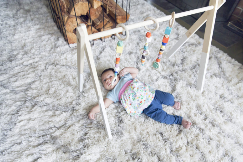 DIY wooden baby gym with colorful geometric beads (via diy.dunnlumber.com)