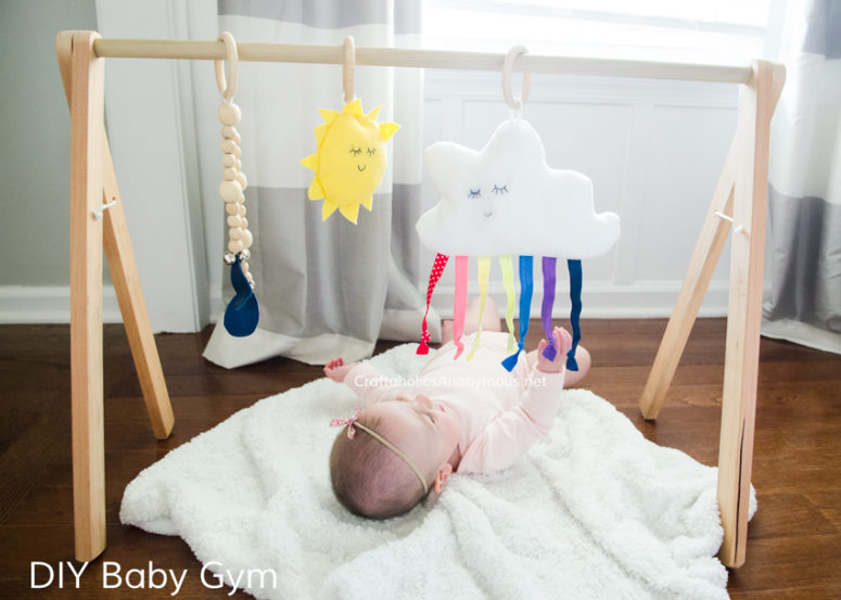 DIY bright and fun baby gym with a rainbow cloud (via www.craftaholicsanonymous.net)