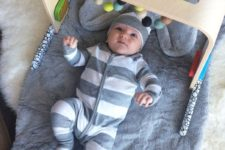 DIY wooden baby gym hack with colorufl felt beads