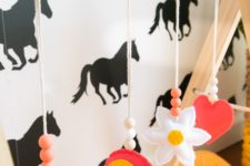 DIY baby gym with colorful sewn toys