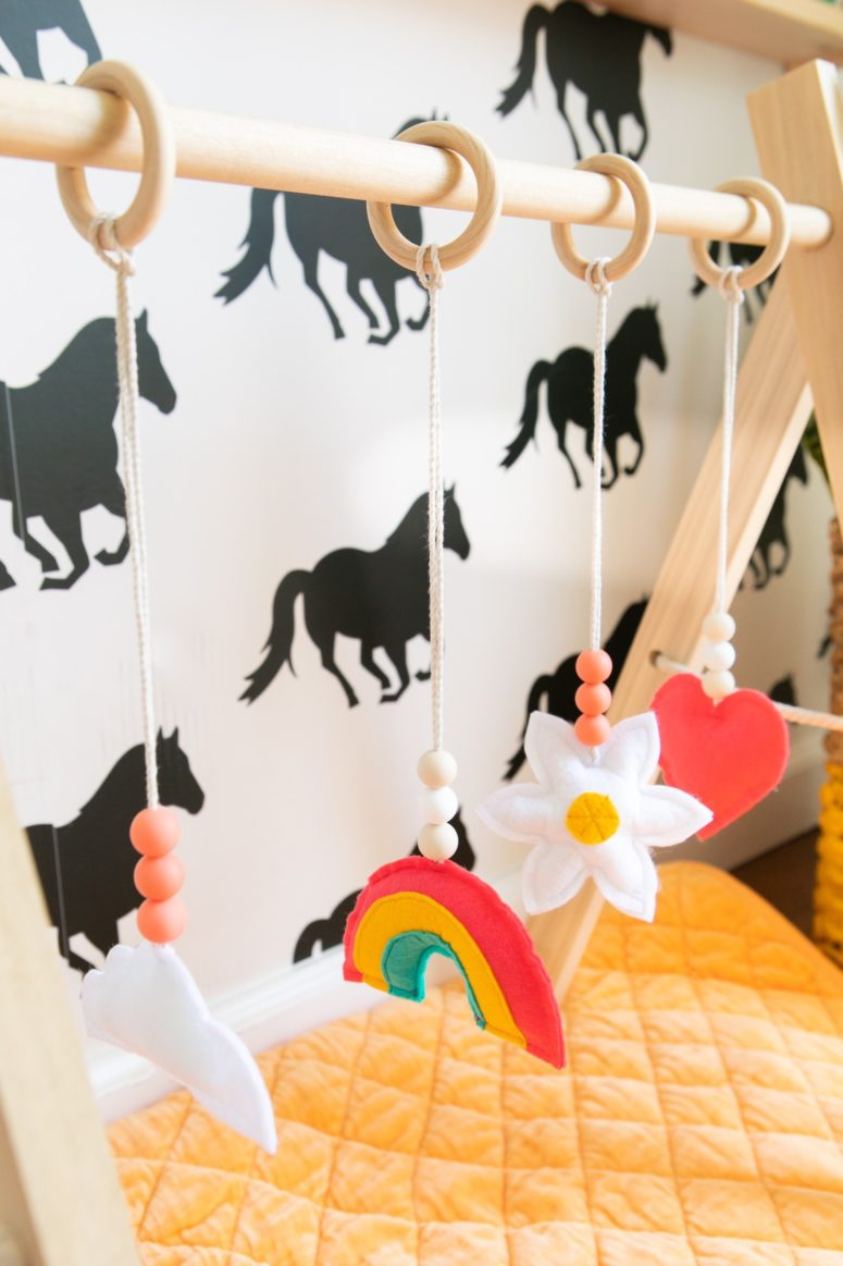 DIY baby gym with colorful sewn toys (via sarahhearts.com)