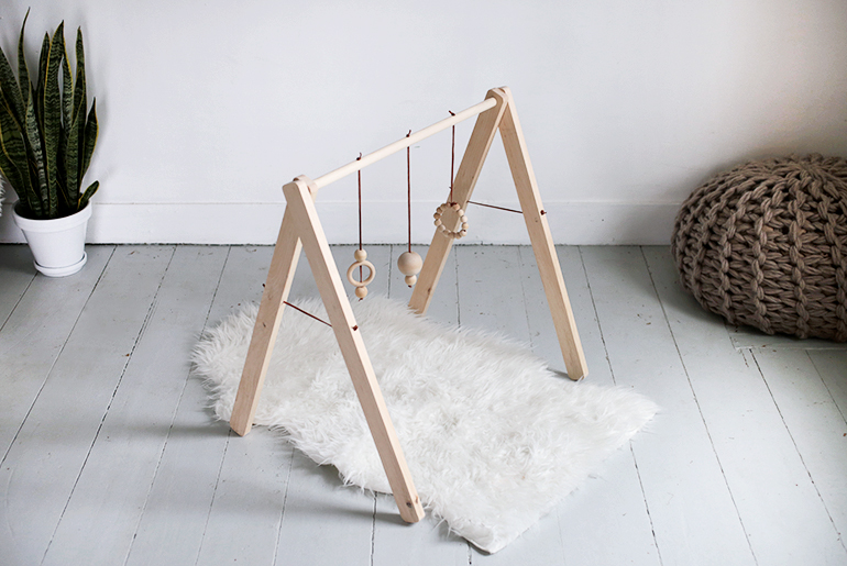DIY contemproary wooden baby gym with beads (via themerrythought.com)